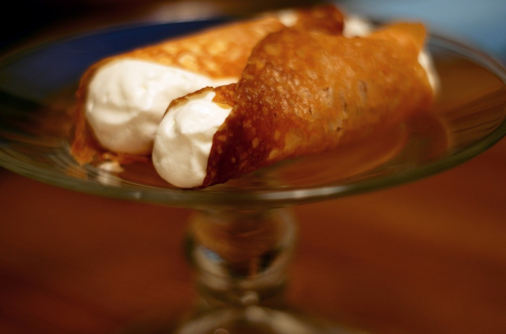 Brandy snaps with whipped cream