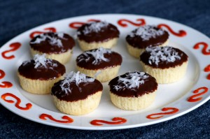 Coconut Cupcakes with Chocolate-Sriracha Ganache