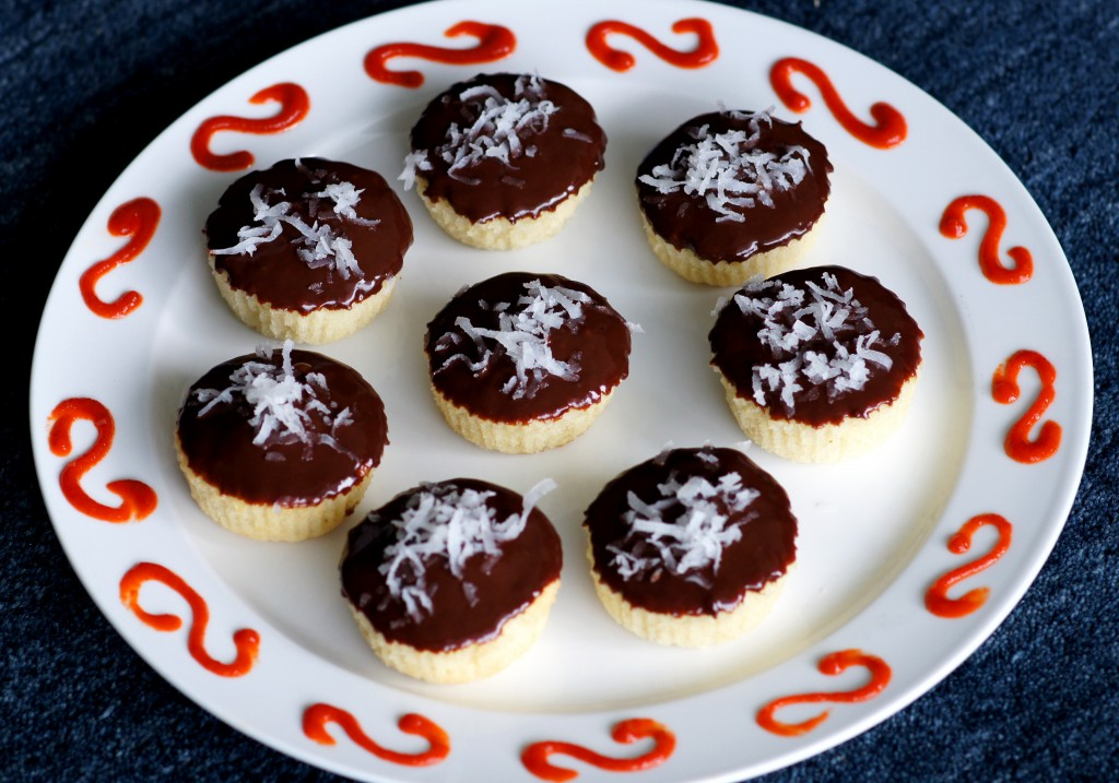 Coconut Cupcakes with Chocolate-Sriracha Ganache image