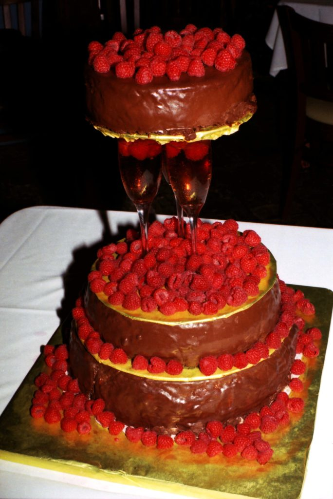My Chocolate Raspberry Truffle Wedding Cake with Champagne Flutes