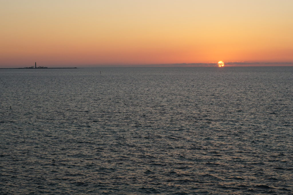 The Sunset from Fort Jefferson; Loggerhead Key and Lighthouse at Left