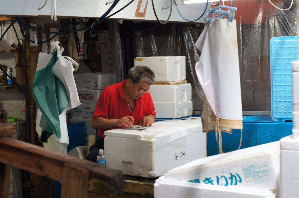 Tsukiji Market Wholesaler Calculating the Sales for the Day
