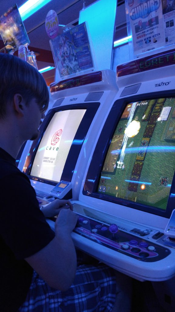 Corey Playing Arcade Games in Akihabara