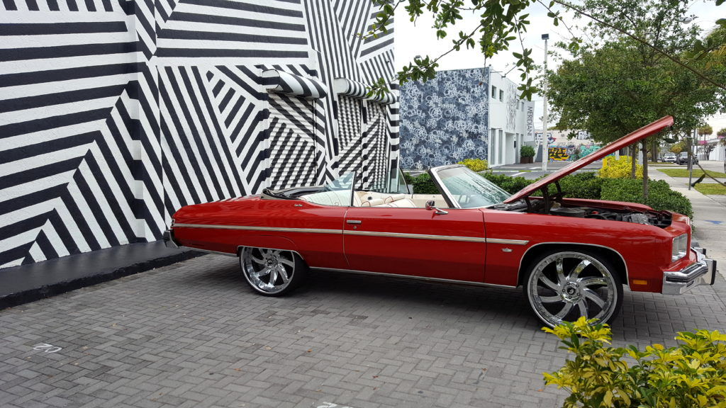Red Convertible in Front of The Wynwood Building