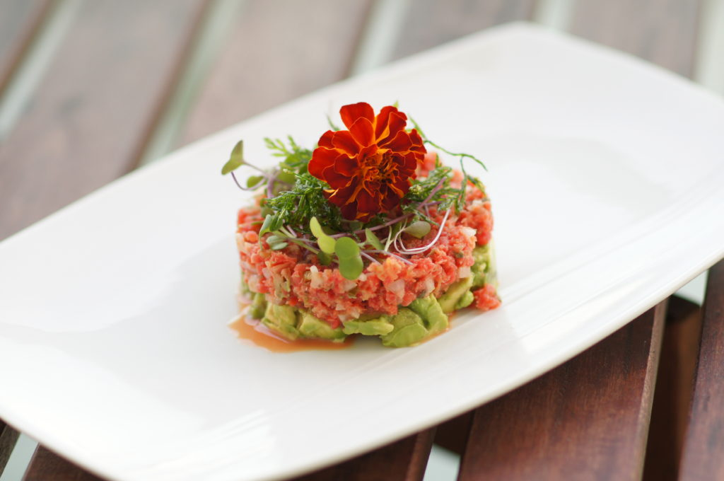 Carrot Tartare with Microgreens, Fried Carrot Tops, and Edible Flowers