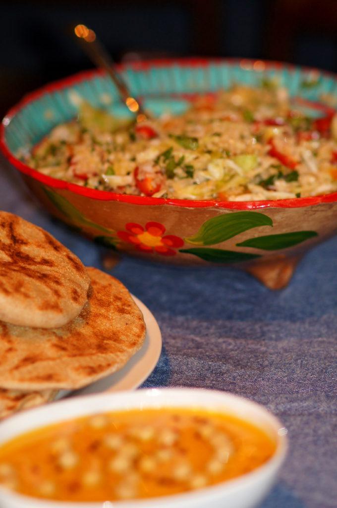 Harrisa Hummus, Fresh Pitas, and Cabbage Tabouleh with Baharat Seasoning