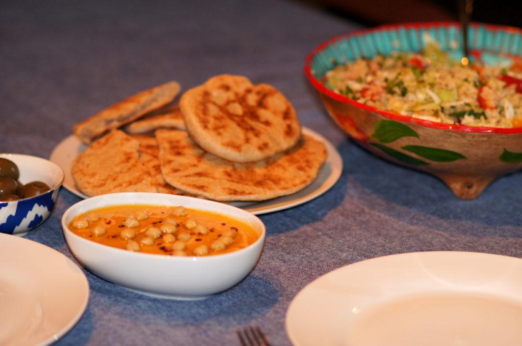 Olives, Harissa Hummus, Homemade Pitas, and Tabouleh with Baharat Seasoning